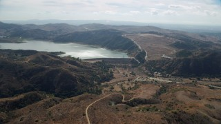 AX0159_160 - 8K stock footage aerial video approaching Irvine Lake and Santiago Dam, Orange, California