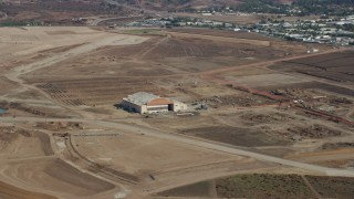 AX0159_167 - 8K stock footage aerial video of a hangar at an abandoned military airport, Irvine, California