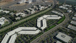 AX0159_174 - 8K stock footage aerial video orbiting a business park, Irvine, California