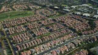 AX0159_178 - 8K stock footage aerial video orbiting a neighborhood of tract homes, Aliso Viejo, California