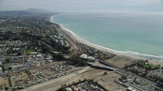 AX0159_187 - 8K stock footage aerial video approaching the beach and Coast Highway in San Juan Capistrano, California