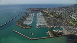 AX0159_188 - 8K stock footage aerial video of breakwaters around Dana Point Harbor, and seaside neighborhoods in Dana Point, California