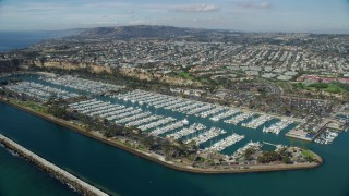 AX0159_189 - 8K stock footage aerial video of Dana Point Harbor and seaside neighborhoods in Dana Point, California