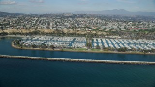 AX0159_190 - 8K stock footage aerial video of Dana Point Harbor and oceanfront neighborhoods in Dana Point, California