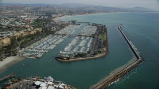 AX0159_192 - 8K stock footage aerial video approaching boats docked at Dana Point Harbor in Dana Point, California