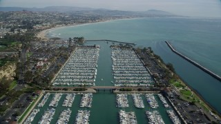 AX0159_193 - 8K stock footage aerial video flying over boats docked at Dana Point Harbor in Dana Point, California