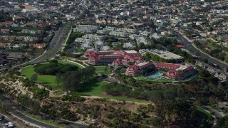 AX0159_196 - 8K stock footage aerial video orbiting and approaching Laguna Cliffs Marriott Resort & Spa in Dana Point, California