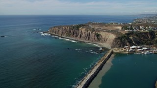 AX0159_198 - 8K stock footage aerial video flying over Dana Point Harbor and by clifftop mansions in Dana Point, California