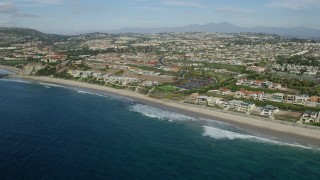 AX0159_200 - 8K stock footage aerial video of beachfront mansions by Dana Strands Beach in Dana Point, California