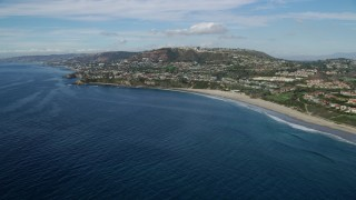 AX0159_201 - 8K stock footage aerial video flying by homes overlooking the ocean and Dana Strands Beach in Laguna Beach, California
