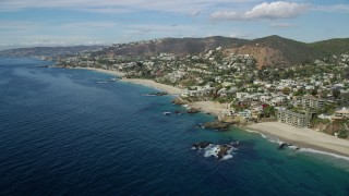 AX0159_205 - 8K stock footage aerial video of oceanfront homes beside Table Rock Beach, West Street Beach in Laguna Beach, California