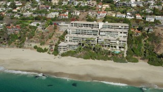 AX0159_206 - 8K stock footage aerial video of Laguna Royale Condominiums and West Street Beach in Laguna Beach, California