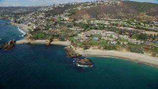 AX0159_207 - 8K stock footage aerial video of Treasure Island Beach and Montage Laguna Beach hotel in Laguna Beach, California