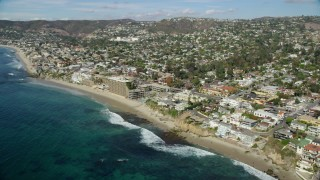 AX0159_209 - 8K stock footage aerial video of Cactus Point, Arch Cove, Surf and Sand Resort Hotel, Laguna Beach, California