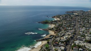 AX0159_211 - 8K stock footage aerial video flying over coves and bay near coastal highway, Laguna Beach, California