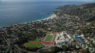 AX0159_217 - 8K stock footage aerial video flying over Laguna Beach High School and sports fields, Laguna Beach, California