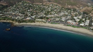 AX0159_219 - 8K stock footage aerial video of clear blue waters along Main Beach Park, Laguna Beach, California