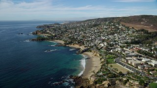 AX0159_223 - 8K stock footage aerial video flying over coastline and Heisler Park, Recreation Point, Diver's Cove, Laguna Beach, California