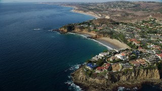 AX0159_226 - 8K stock footage aerial video passing by Emerald Bay, Emerald Point, Cameo Cove, Abalone Point,  Laguna Beach, California
