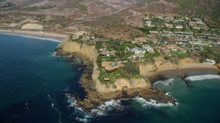 AX0159_227 - 8K stock footage aerial video orbiting houses on Abalone Point, Laguna Beach, California