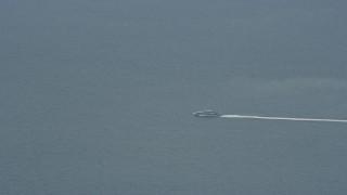 AX0159_242 - 8K stock footage aerial video of a ferry heading towards Catalina Islands, California