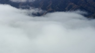 AX0159_248 - 8K stock footage aerial video of low clouds over Catalina Island, California