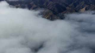 AX0159_249 - 8K stock footage aerial video of low clouds over Avalon, Catalina Island, California