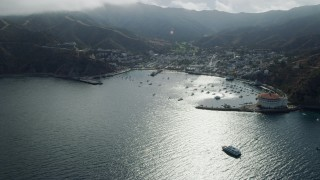 AX0159_255 - 8K stock footage aerial video of the bay and the town of Avalon, Catalina Island, California