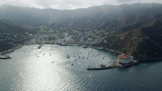 AX0159_259 - 8K stock footage aerial video of boats anchored in Avalon Bay by the island town, Santa Catalina Island, California