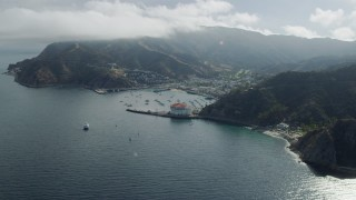 AX0159_260 - 8K stock footage aerial video flying away from the harbor and the island town of Avalon, Santa Catalina Island, California