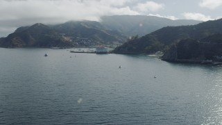 AX0159_261 - 8K stock footage aerial video approaching the harbor and island town of Avalon on Santa Catalina Island, California