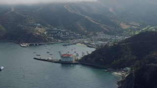 AX0159_265 - 8K stock footage aerial video flying away from the small island town of Avalon, Santa Catalina Island, California