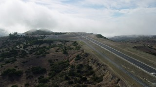 AX0159_272 - 8K stock footage aerial video approaching the Catalina Airport runway on Santa Catalina Island, California