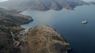 AX0160_007 - Aerial stock footage of Flyby the USC Wrigley Marine Science Center in Two Harbors, Santa Catalina Island, California