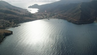 AX0160_008 - Aerial stock footage of Flyby the Two Harbors island community on Santa Catalina Island, California