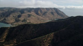 AX0160_011 - 8K stock footage aerial video flying by and approaching hills and Two Harbors, Santa Catalina Island, California
