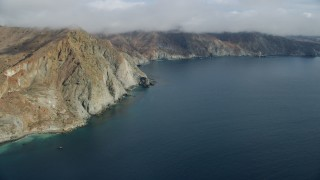AX0160_015 - 8K stock footage aerial video of steep cliffs on the coast of Santa Catalina Island, California