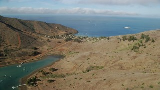 AX0160_017 - 8K stock footage aerial video flying by Catalina Harbor and the Two Harbors island community on Santa Catalina Island, California