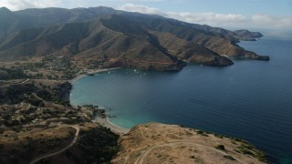 AX0160_019 - 8K stock footage aerial video flying by and away from Two Harbors, Santa Catalina Island, California