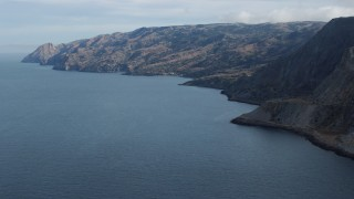 AX0160_020 - 8K stock footage aerial video of steep cliffs and coastline of Santa Catalina Island, California