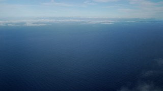 AX0160_023 - 8K stock footage aerial video of low level clouds and open water in the Pacific Ocean off the coast of Southern California