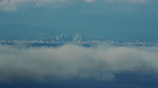 AX0160_024 - 8K stock footage aerial video of Downtown Los Angeles skyline seen from Catalina Island, California