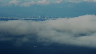 AX0160_025 - 8K stock footage aerial video of Downtown Los Angeles skyline seen from Catalina Island, California