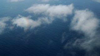 AX0160_028 - 8K stock footage aerial video flying over wispy clouds and open water in the Pacific Ocean, Southern California