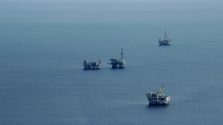 AX0160_033 - 8K stock footage aerial video of oceanic oil rigs off the coast of Southern California