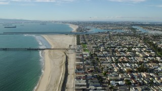 AX0160_055 - 8K stock footage aerial video of coastal neighborhoods around an inlet and Alamitos Bay in Long Beach, California