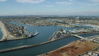 AX0160_056 - 8K stock footage aerial video of coastal neighborhoods around Alamitos Bay in Long Beach, California