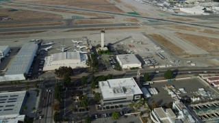AX0160_066 - 8K stock footage aerial video approaching the control tower and runways at Long Beach Airport, California