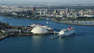 AX0161_008 - 8K stock footage aerial video of a cruise ship and Queen Mary docked near Downtown Long Beach, California