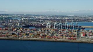 AX0161_012 - 8K stock footage aerial video of shipping containers and cargo cranes at the Port of Los Angeles, California